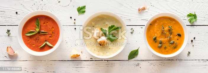 Vegetable Soups. Set of various seasonal vegetable soups and organic ingredients, top view, banner. Homemade colorful vegan vegetarian soups.