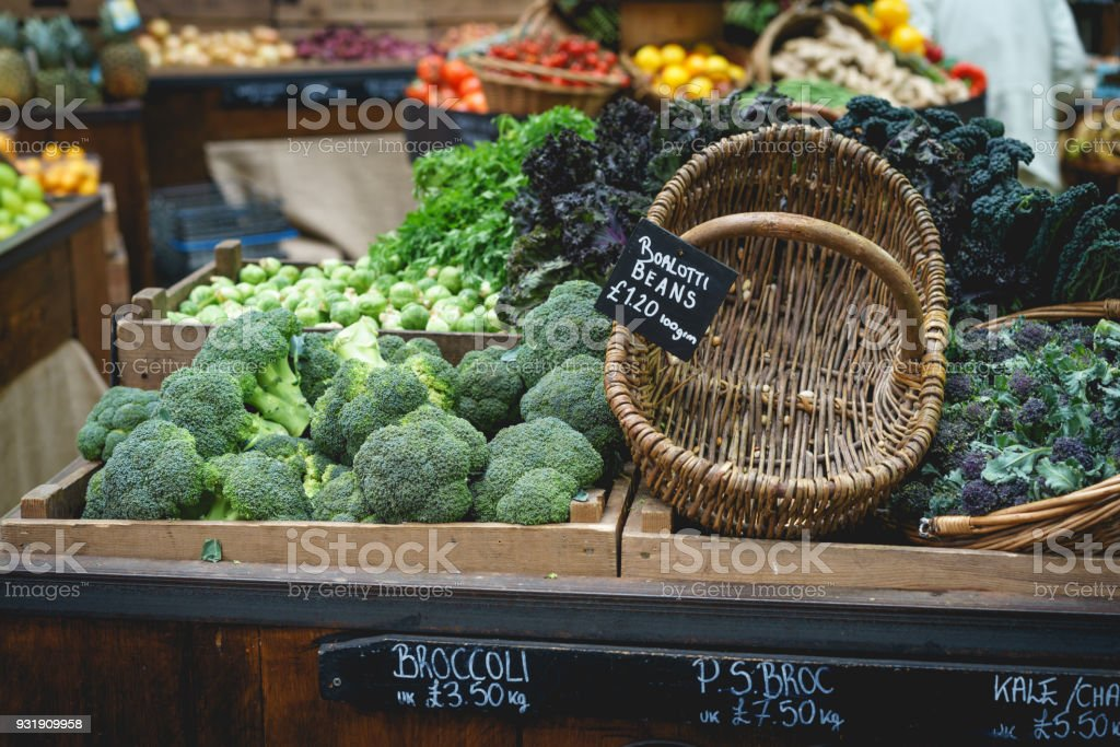 Vegetable stall in farmer market, including celery, parsnips and broccoli. stock photo