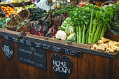 Vegetable stall in farmer market, including celery, parsnips and broccoli. Landscape format.