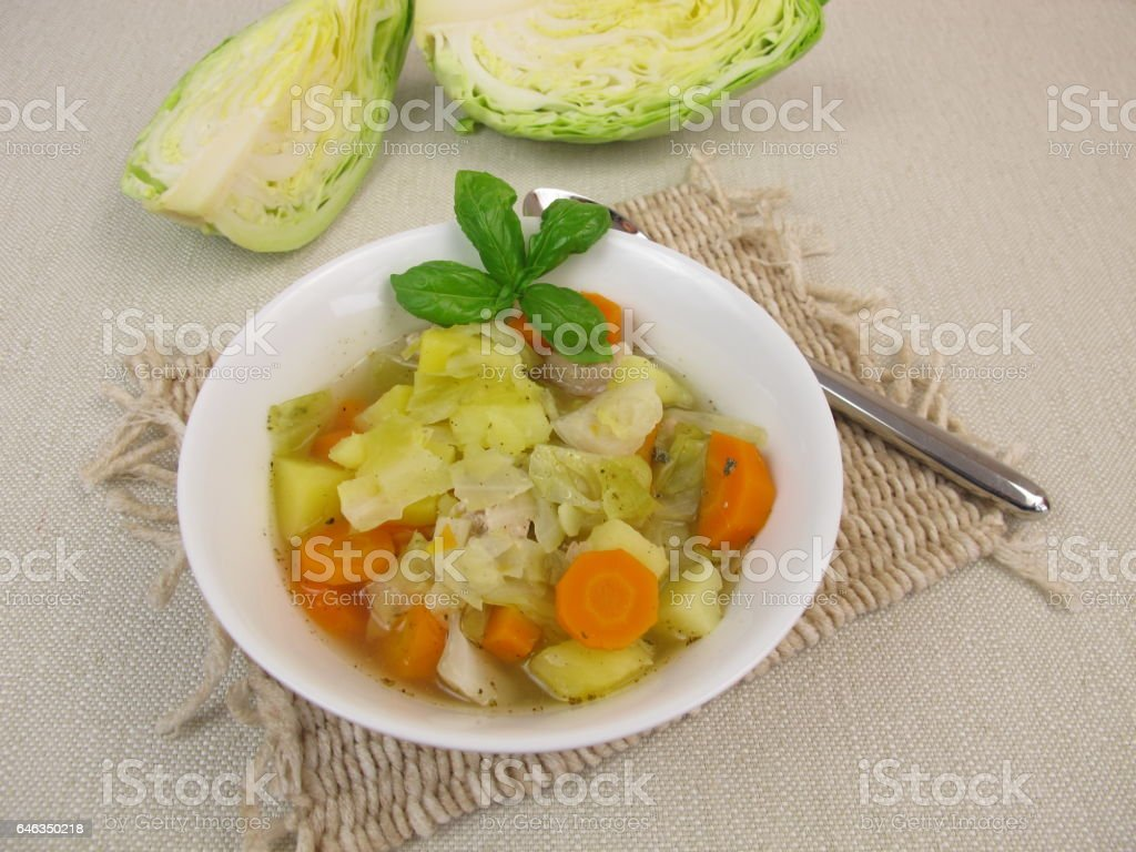 Vegetable stew with cone cabbage in soup bowl stock photo