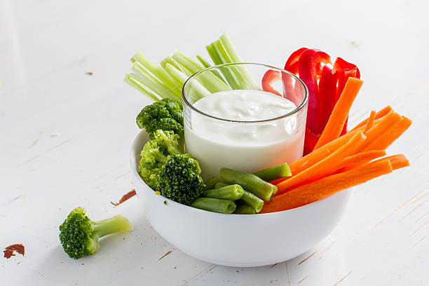 Vegetable sticks (pepper, celery, carrot, broccoli) in white bowl stock photo