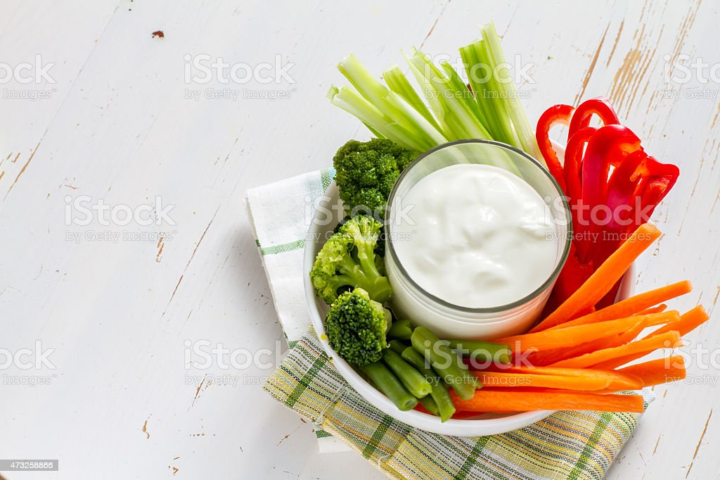 Vegetable sticks (pepper, celery, carrot, broccoli) in white bowl stock photo