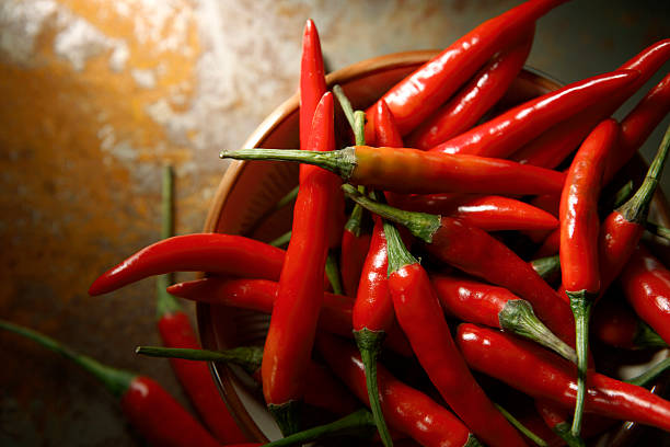 vegetable stills: chili pepper red - chilli stock photos and pictures