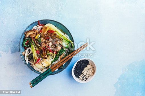 Vegetable Udon Noodle Soup. Sesame Udon with  Bok Choy and Shiitake Mushrooms, ready to eat. Top view, blank space