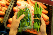 istock Vegetable wrapped in banana leaves vs. plastic packaging 1147010293