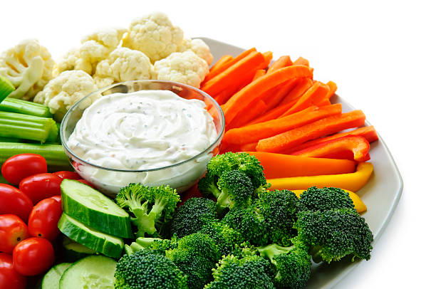 Vegetables and dip stock photo