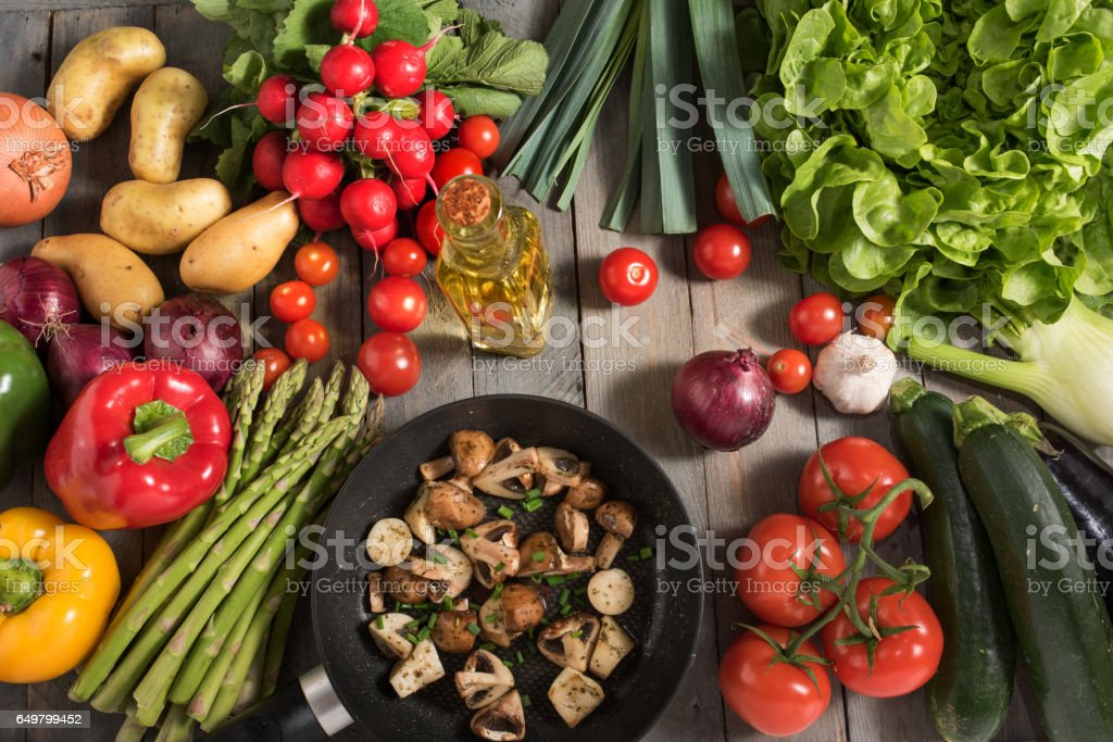 Vegetables and fried mushrooms stock photo