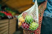 istock Vegetables and fruit in reusable bag on a farmers market, zero waste concept 1159376903