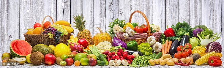 istock Vegetables and fruits background 821615102