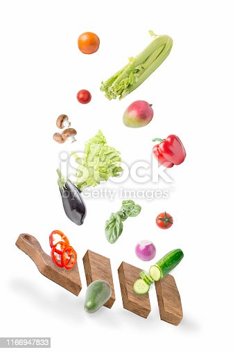 Vegetables and fruits falling on the Board.