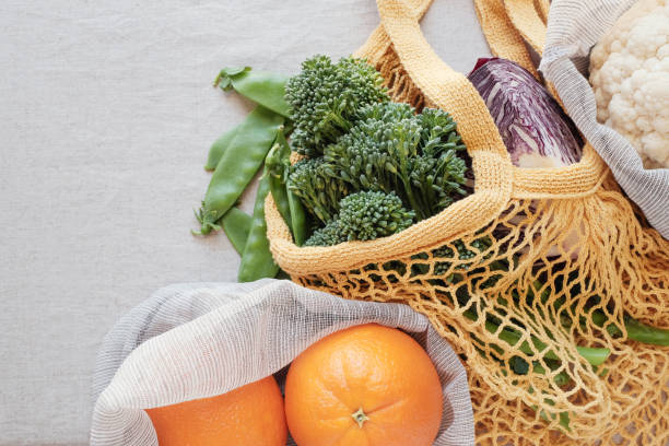 vegetables and fruits in reusable bag, Eco living, plastic free and zero waste concept stock photo