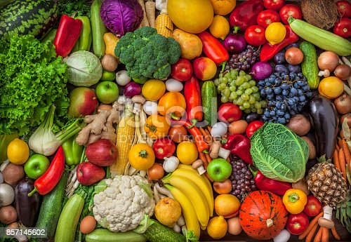istock Vegetables and fruits large overhead mix group on colorful background 857145602