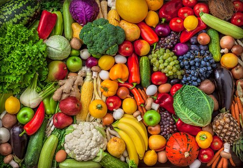 Vegetables and fruits large overhead mix group on colorful background