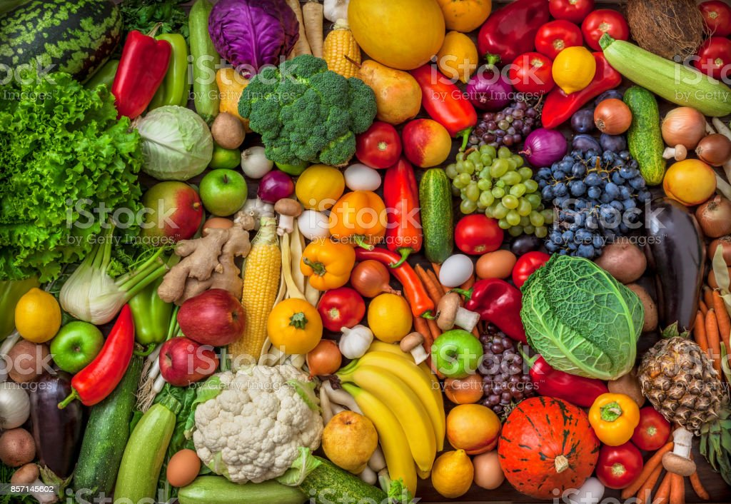 Vegetables and fruits large overhead mix group on colorful background stock photo