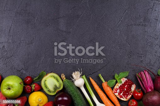 istock vegetables and fruits on black background 538655558