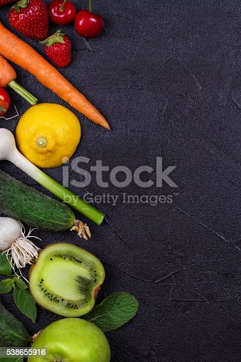 istock vegetables and fruits on black background 538655916