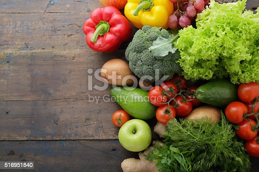 istock vegetables and fruits on boards with space for text 516951840