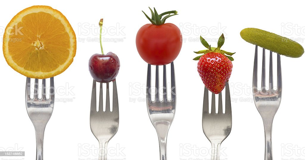vegetables and fruits on forks - diet concept royalty-free stock photo