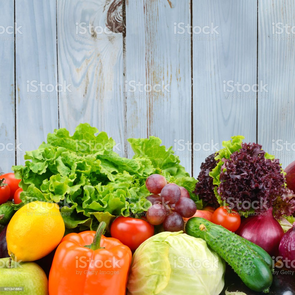 Vegetables and fruits on light blue wooden wall background. stock photo