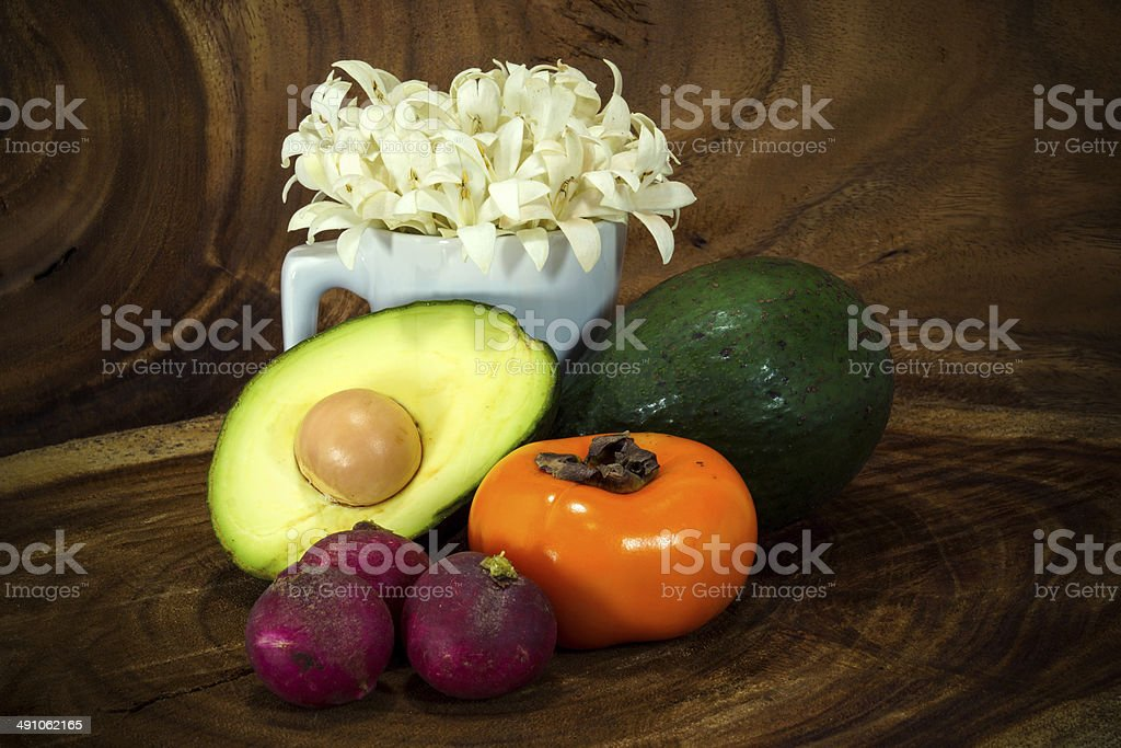Vegetables and fruits on wooden background. stock photo