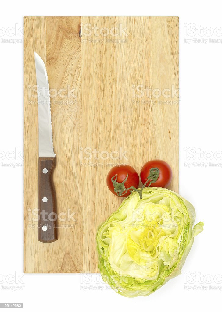 Vegetables and knife on a cutting board stock photo