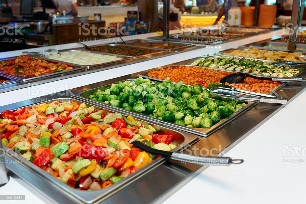 Vegetables and other foods in restaurant stock photo