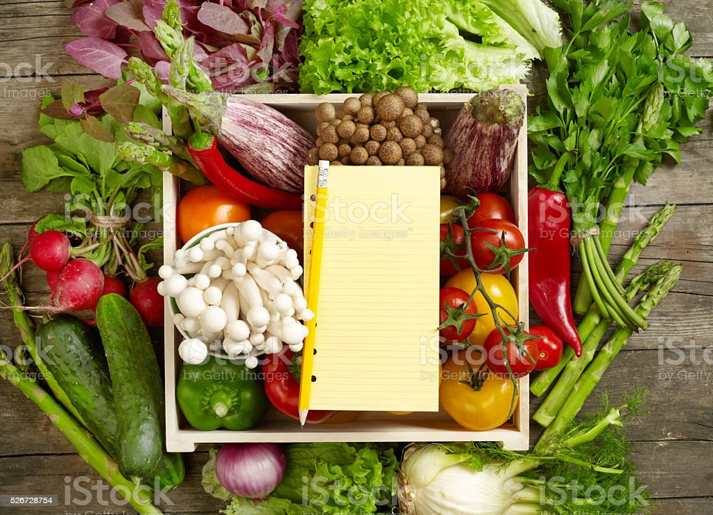 Vegetables and shopping list stock photo