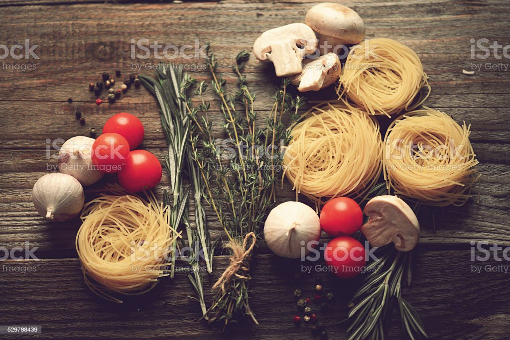 vegetables and spices on wooden background stock photo