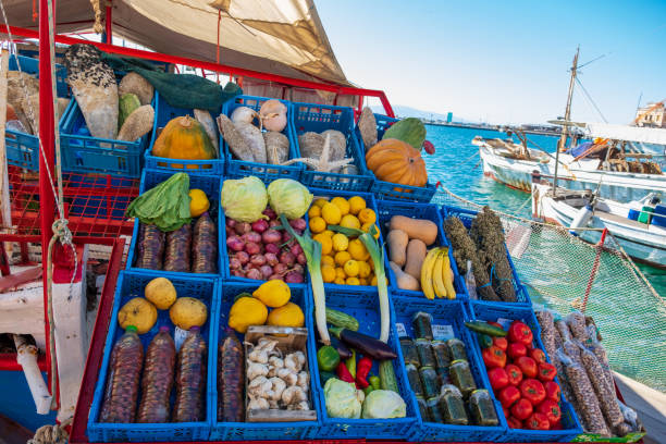 Vegetables at a market stall on a boat in Aegina port in Greece stock photo