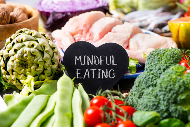 vegetables, chicken and text mindful eating stock photo