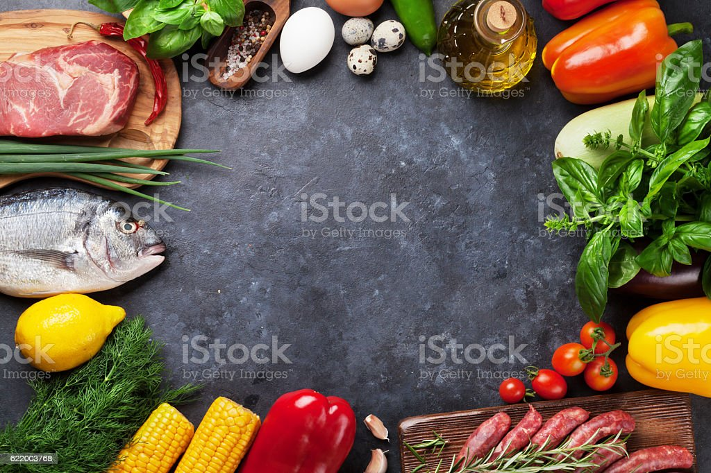 Vegetables, fish and meat cooking stock photo