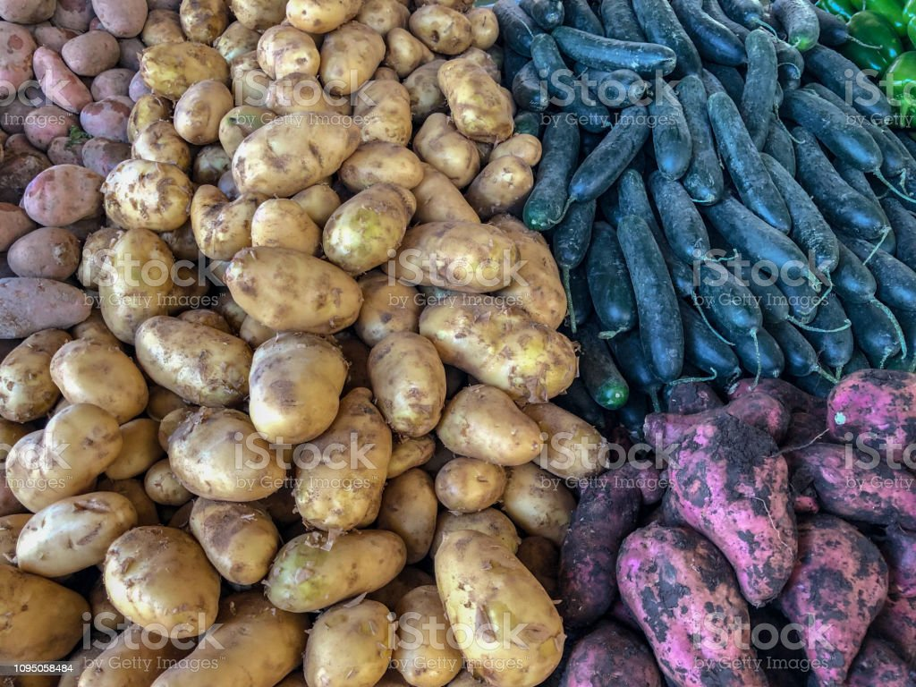 Potatoes and vegetables for sale at a Moroccan souk