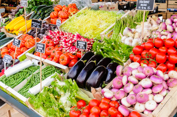 Vegetables for sale at an outdoor market stall Vegetables for sale at an outdoor market stall grocer stock pictures, royalty-free photos & images