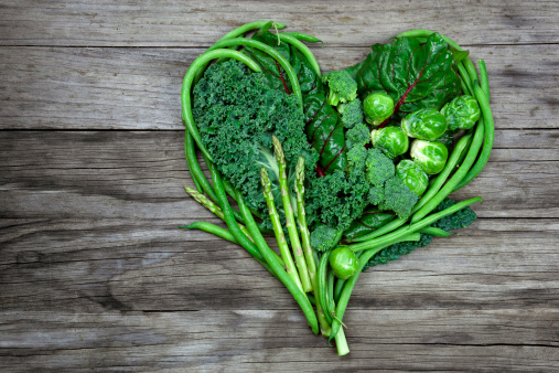 istock Vegetables - Green Heart Shape on Wood background 155142949