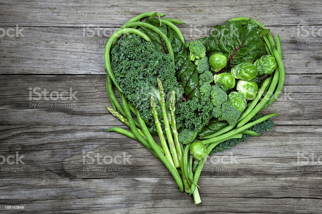 Vegetables - Green Heart Shape on Wood background stock photo