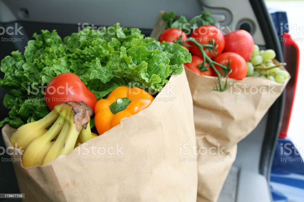 Vegetables In Bags Sitting The Trunk Of A Car stock photo