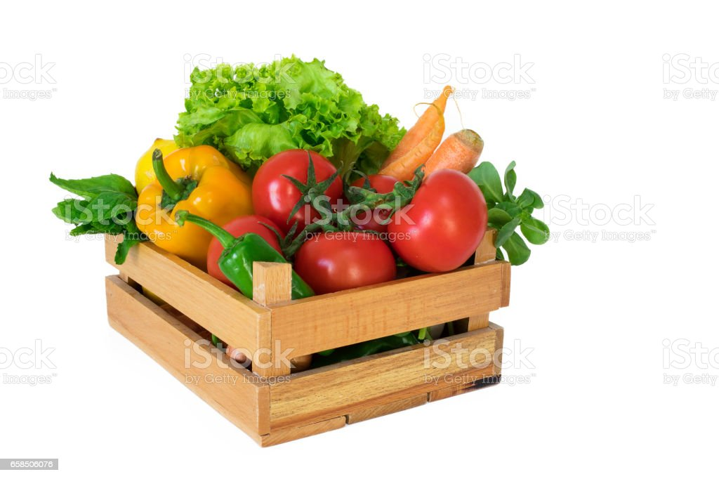 Vegetables in basket on white background stock photo