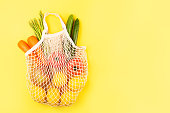 istock Vegetables in fabric shopping bag on yellow background. 1145166459