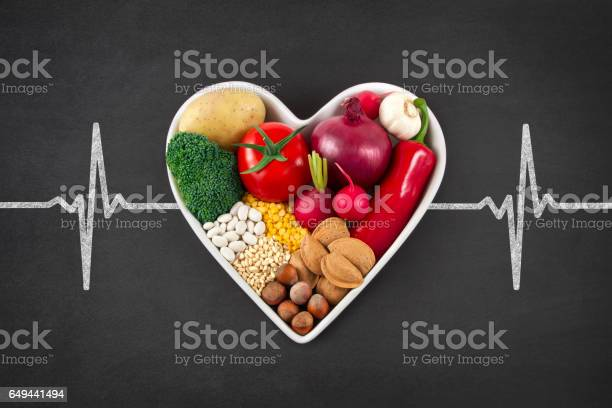 Vegetables In Heart Shaped Bowl On Blackboard Stock Photo - Download Image Now