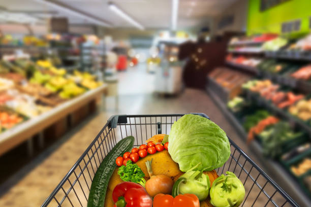 vegetables in shopping card in supermarket vegetables in shopping card in supermarket market hall stock pictures, royalty-free photos & images