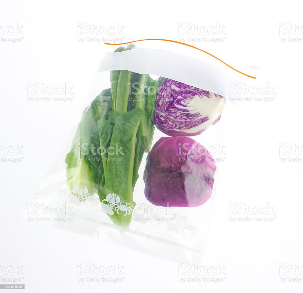 Vegetables in the zipper bag isolated stock photo