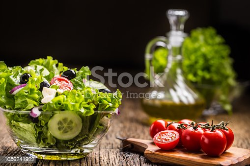 879977192 istock photo Vegetables lettuce salad with tomatoes onion cheese and olives. 1056241922