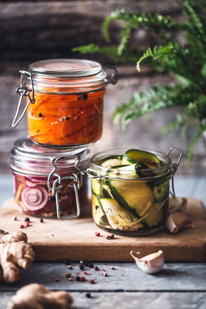 Vegetables Married in Pots. Carrot, Onion and Courgette Pickle for Winter. Légumes Marinés en Pots. Pickle de Carotte, Oignon et Courgette pour l'Hiver. fermenting stock pictures, royalty-free photos & images