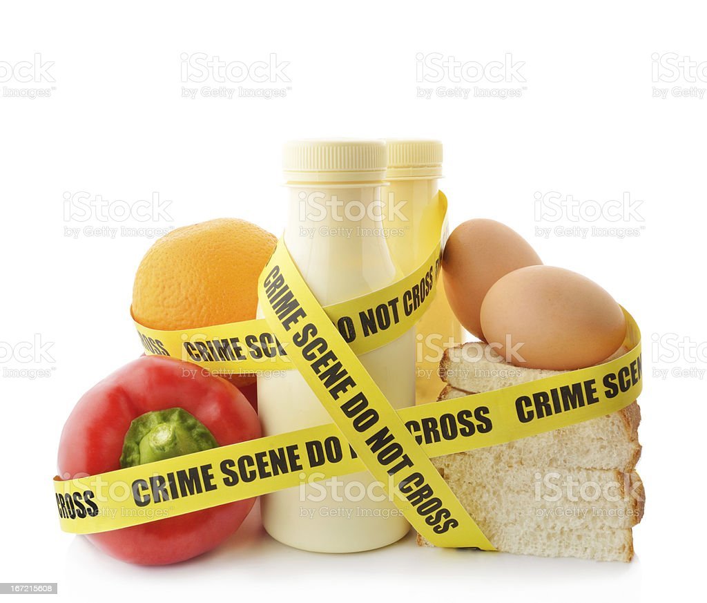 Vegetables, milk, egg and bread wrapped in crime scene tape stock photo