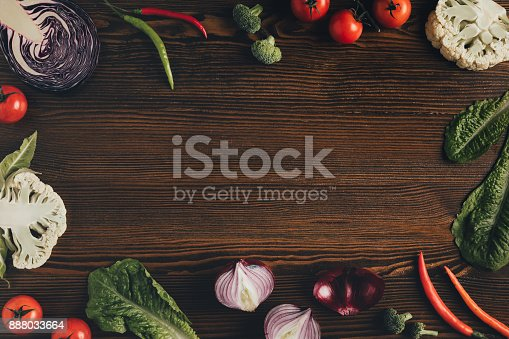 istock vegetables on brown table 888033664