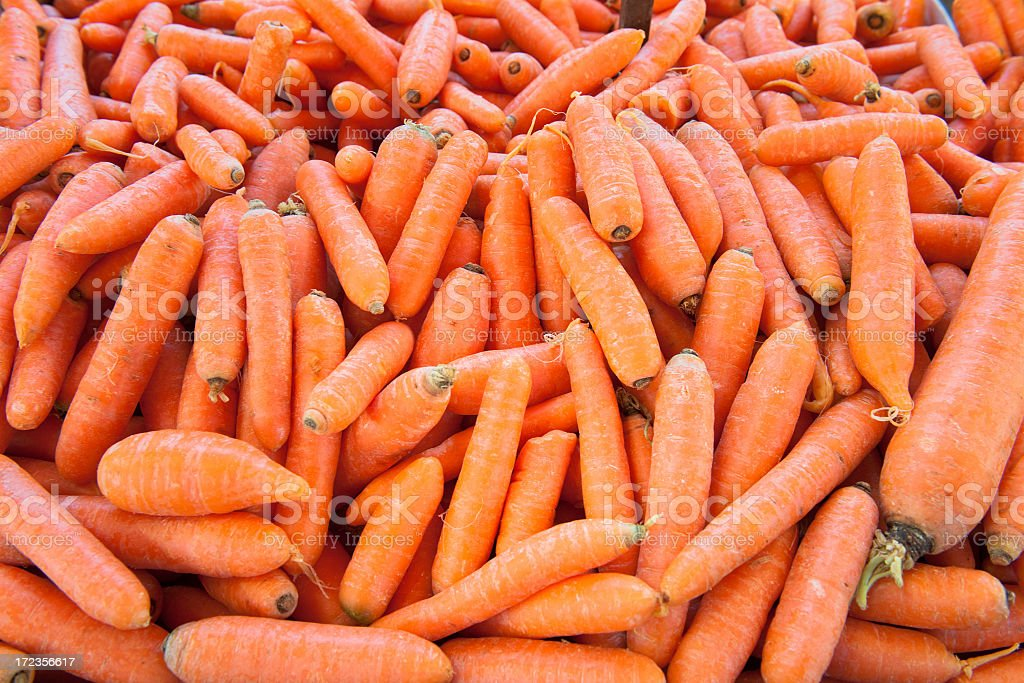 Vegetables on market stall: loose carrots background royalty-free stock photo