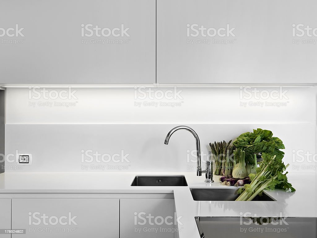 vegetables on the white worktop in a modern kitchen stock photo
