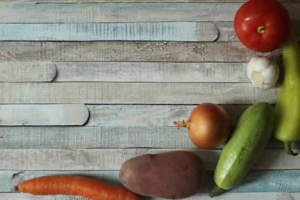 Vegetables on wooden table, studio shot stock photo