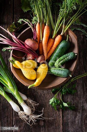 Fresh Garden Vegetables in a Wooden Bowl