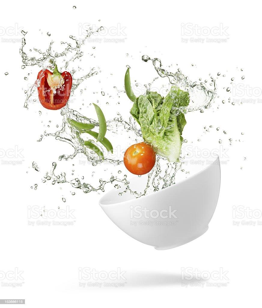 vegetables various type of fresh vegetables splashing out from spilling bowl Bell Pepper Stock Photo